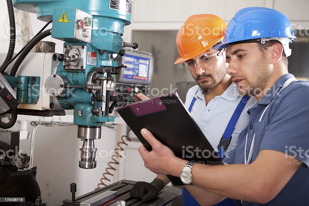 Young Engineer and Foreman stock photo