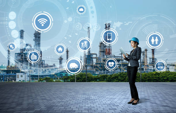 young engineer and smart factory concept. Internet of Things. Sensor Network. stock photo