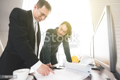 istock Young engineer cunsulting with senior. 1159752596