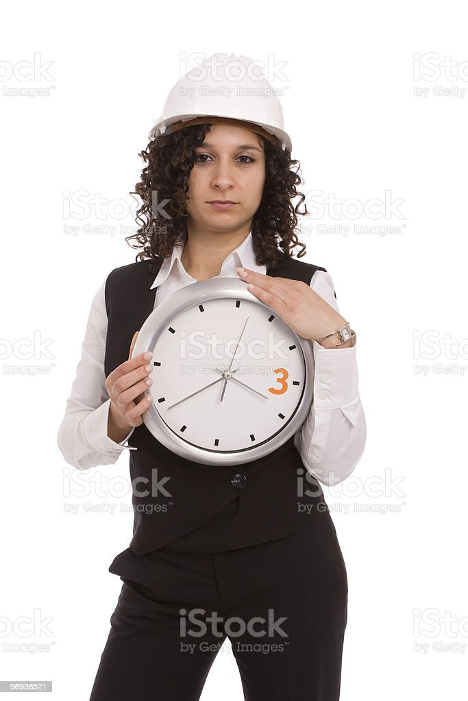 Young engineer holding a clock royalty-free stock photo