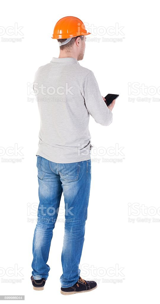 young engineer in a protective helmet with tablet computer in stock photo