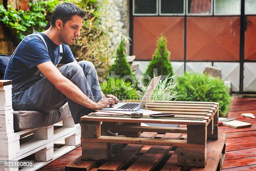 istock Young engineer in the backyard planing 521150805