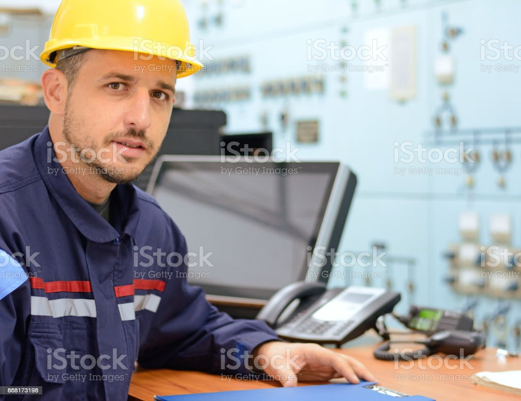 Young engineer in working electrical room in power substation stock photo