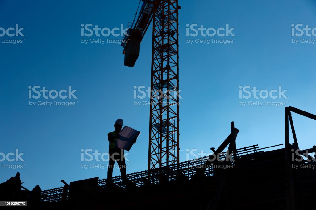 young engineer is checking construction stock photo