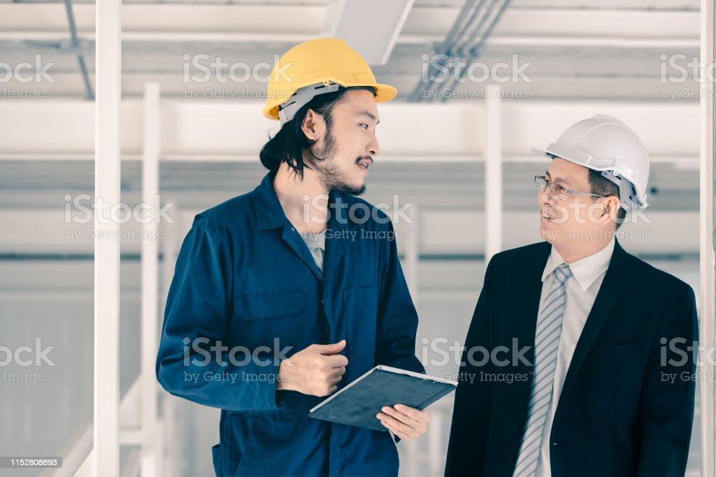 Young Asian engineer use tablet to present his work to senior...