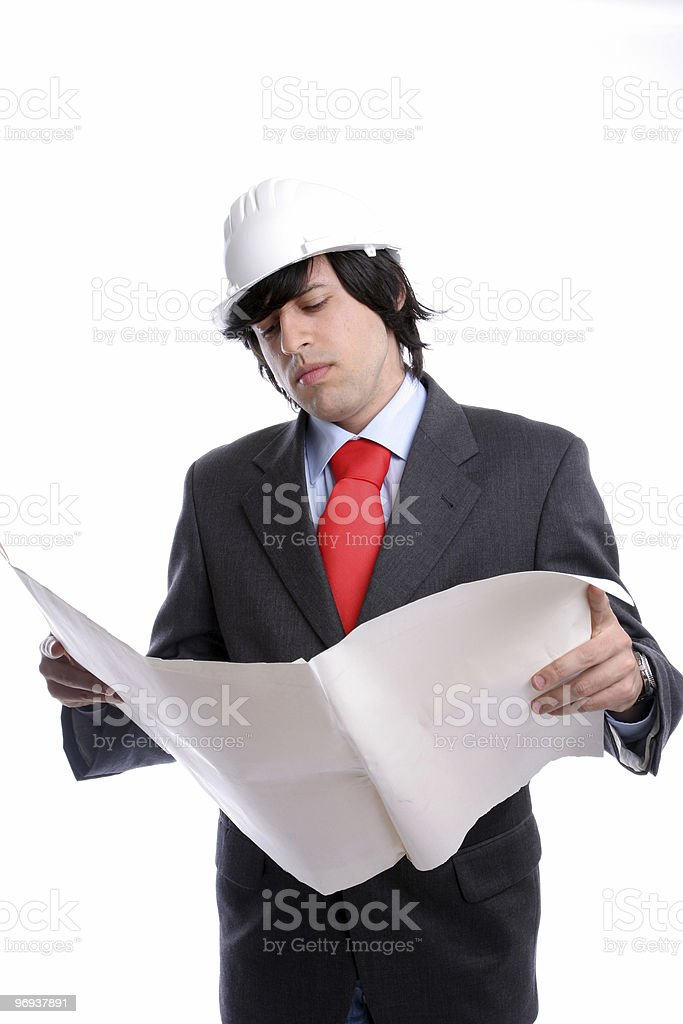 Young Engineer, reading a plan royalty-free stock photo