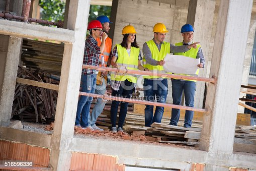 516607254istockphoto Young engineer team show building place as planned 516596336