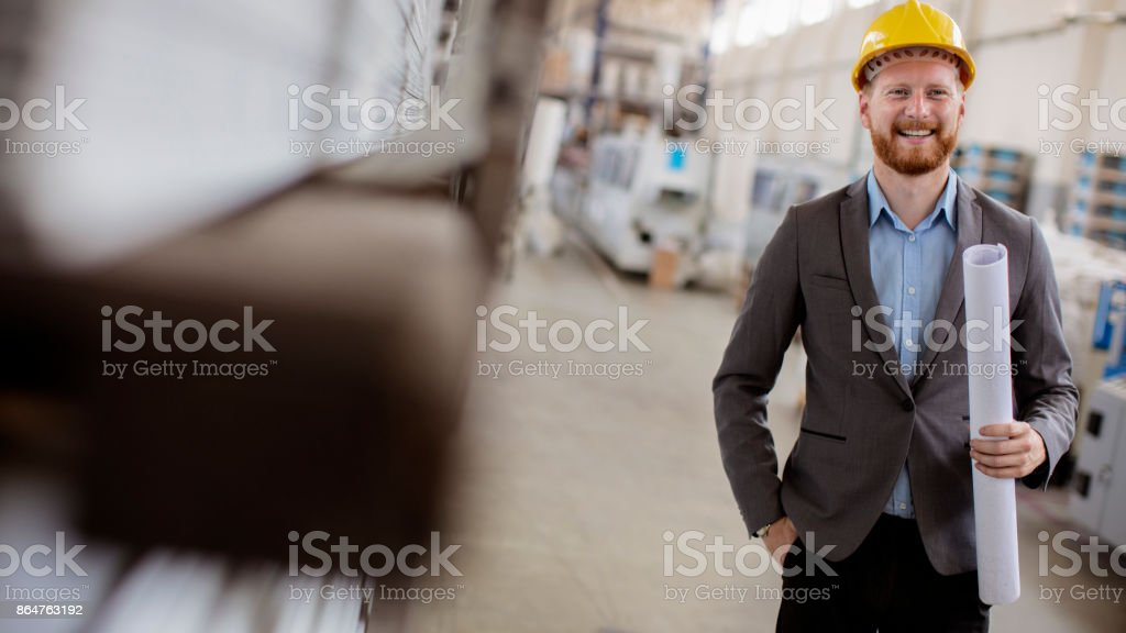 Young engineer wearing yellow hardhat. Developed from RAW; retouched...