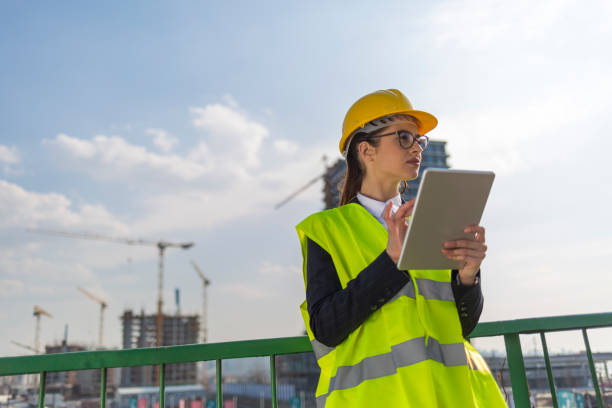 young engineer working at construcion site - civil engineer stock photos and pictures