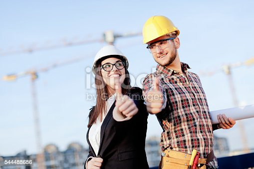 617878058 istock photo Young engineers showing thumbs up 544488686
