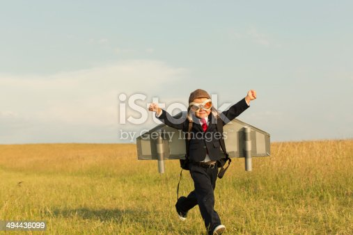 istock Young English Boy Dressed in Suit Wearing Jetpack 494436099