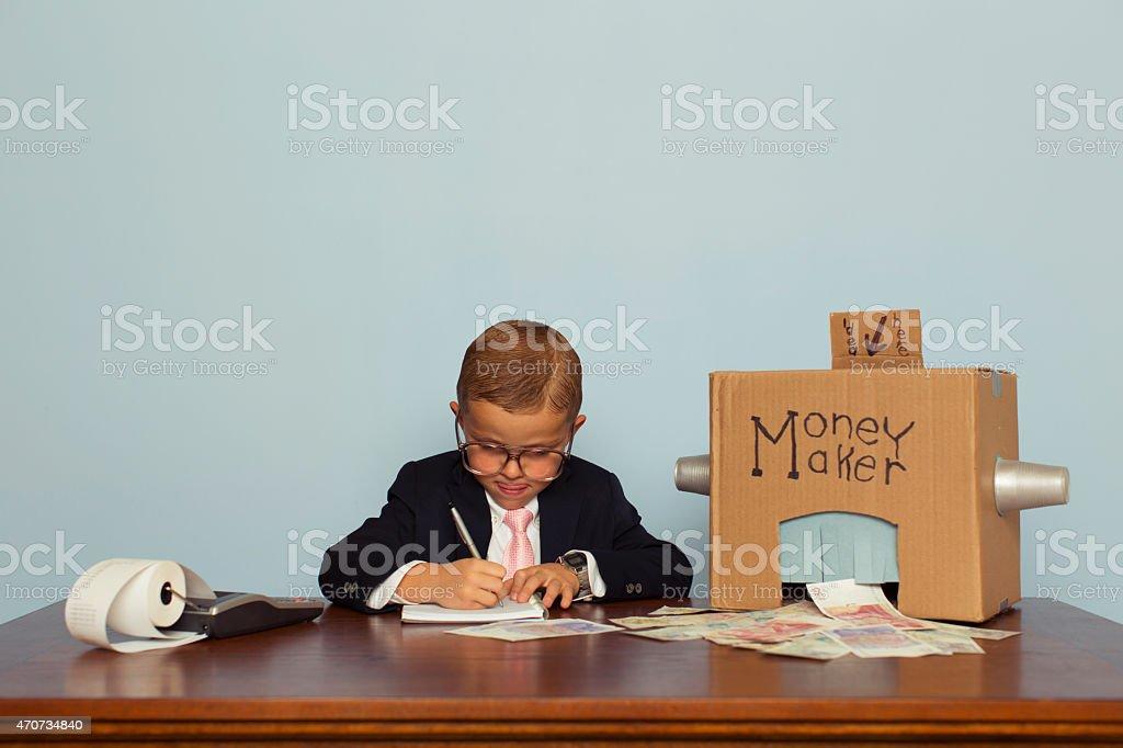Jeune garçon en anglais pour faire de l'argent - Photo