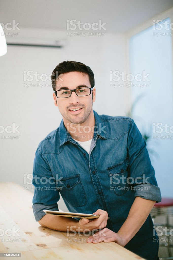 Young entrepreneur at work stock photo