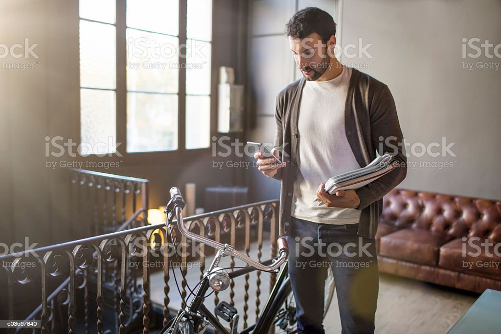 Young entrepreneur businessman texting a message with his smart phone stock photo