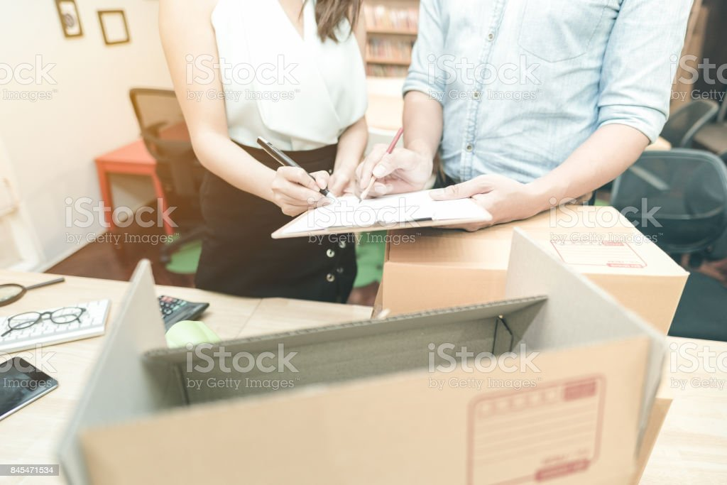 Young entrepreneur checking document with marketing team at home office. stock photo