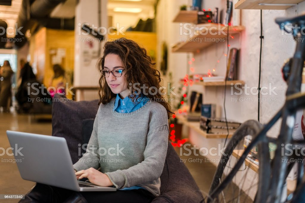 Young entrepreneur female is preparing a presentation on a laptop. stock photo