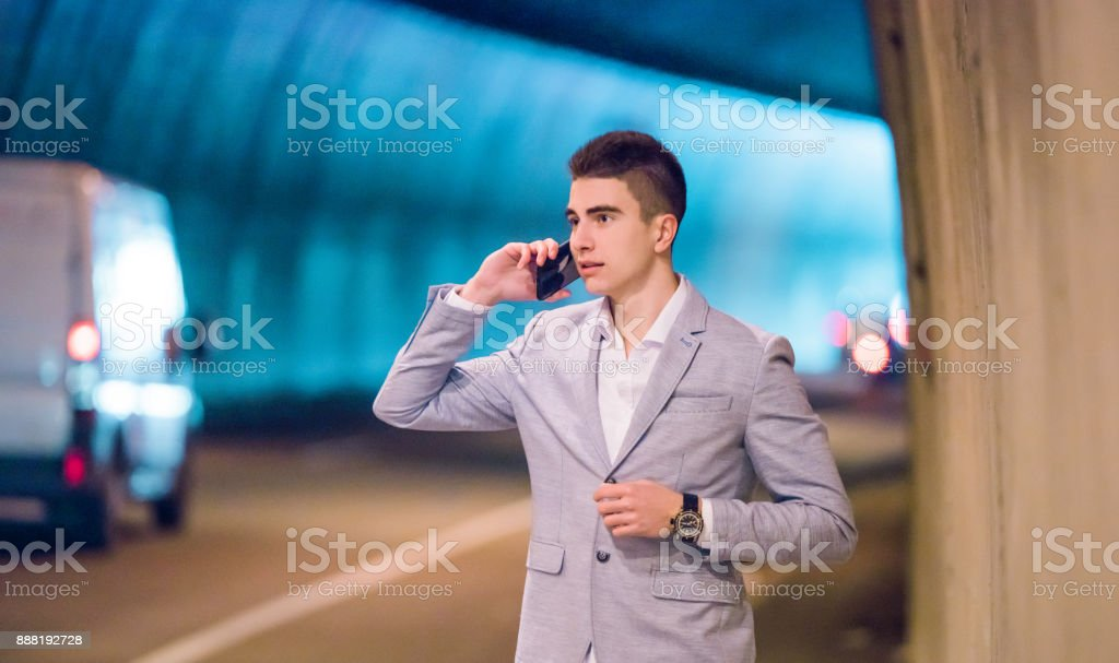 Young entrepreneur in a tunnel has a very strong conncection. stock photo