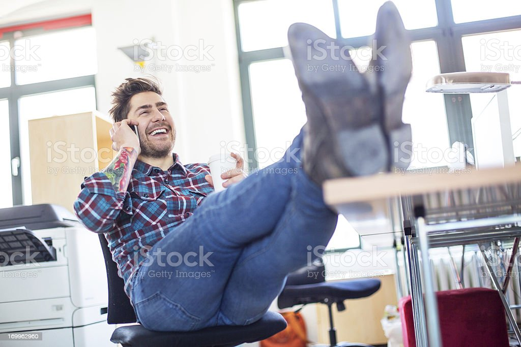 Young entrepreneur relaxing during work stock photo