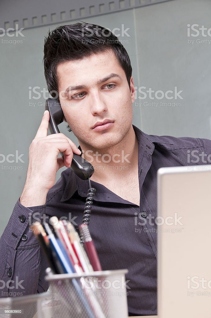 Young Entrepreneur Talking on the Phone royalty-free stock photo
