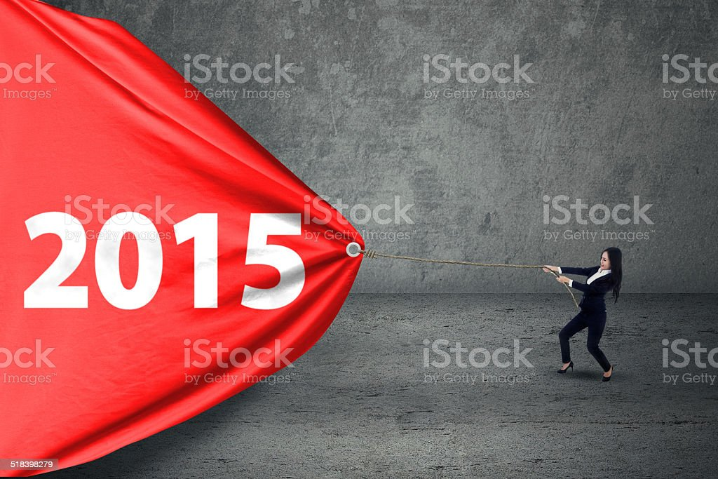 Young entrepreneur with number 2015 stock photo