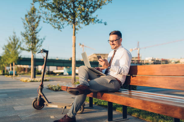 Young entrepreneur working from outside his office stock photo