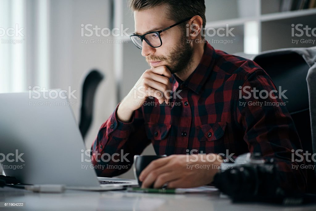 Young entrepreneur working on a new project stock photo