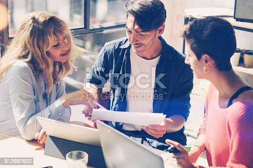 912675036 istock photo Young entrepreneurs are looking for a business solution during work process in modern office.Business people meeting concept.Blurred background.Horizontal. 912687602
