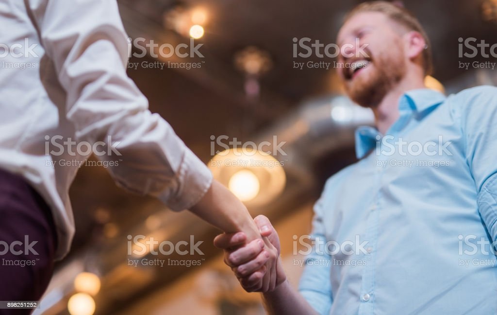 Young entrepreneurs shaking hands. stock photo
