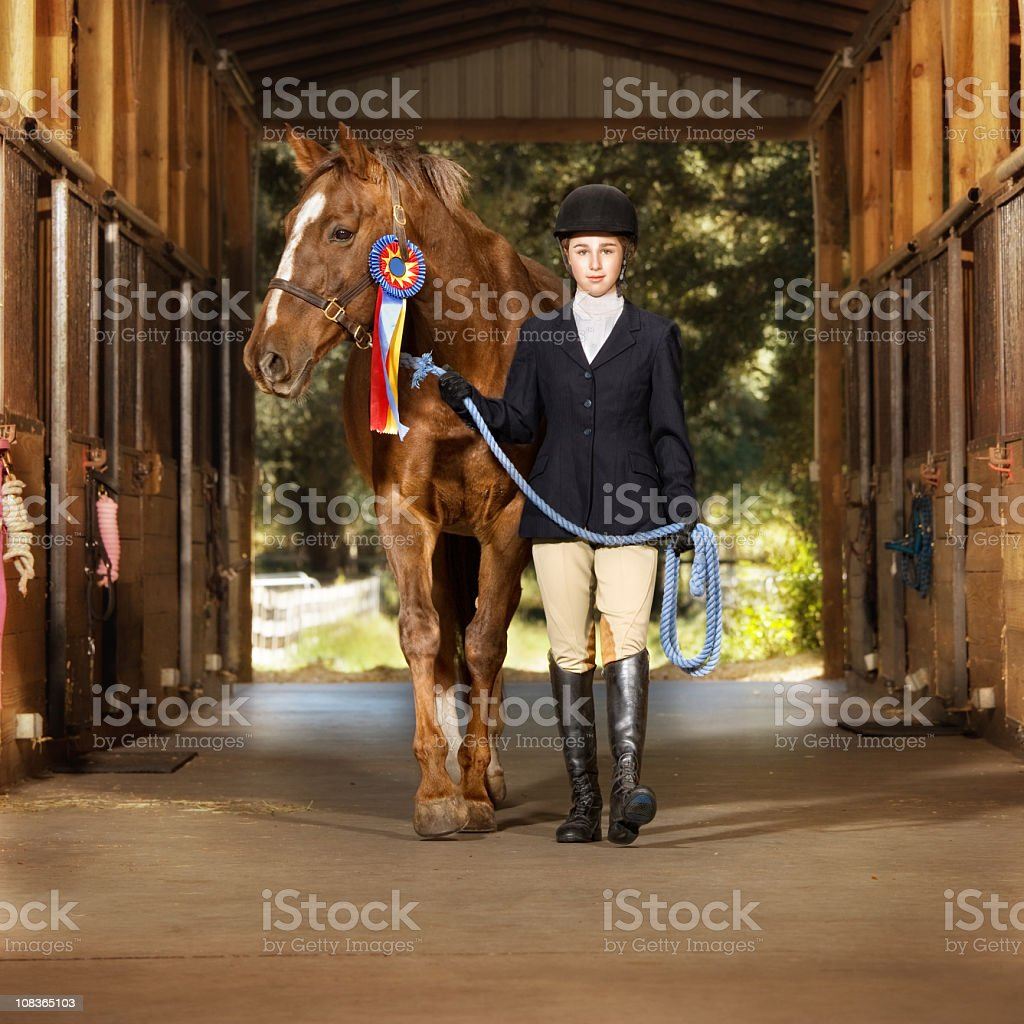 Young equestrian with her horse stock photo