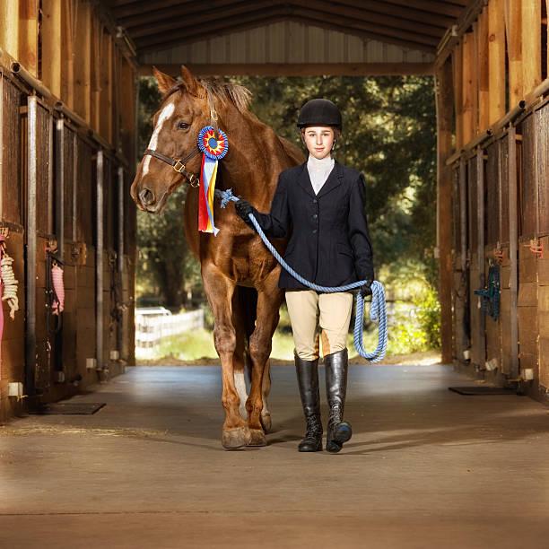 young equestrian with her horse - hästhoppning bildbanksfoton och bilder