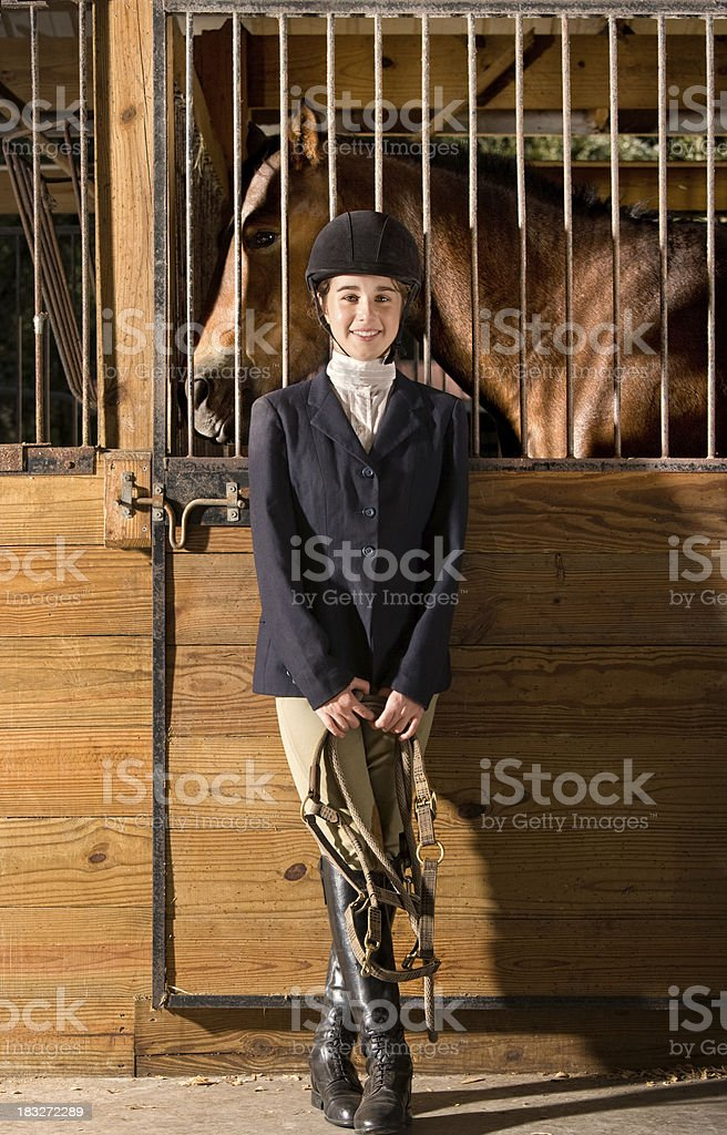 Young equestrian with her horse royalty-free stock photo