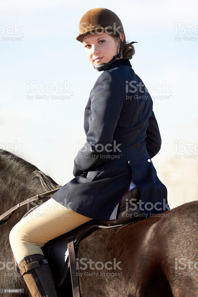 Young equestrienne stock photo