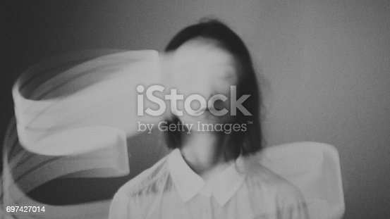 istock Young esoteric relaxing girl with light aura. Virtual reality fantasy art. 697427014