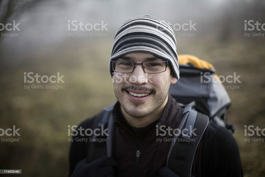 Young Ethnic Backpacker in the Woods stock photo