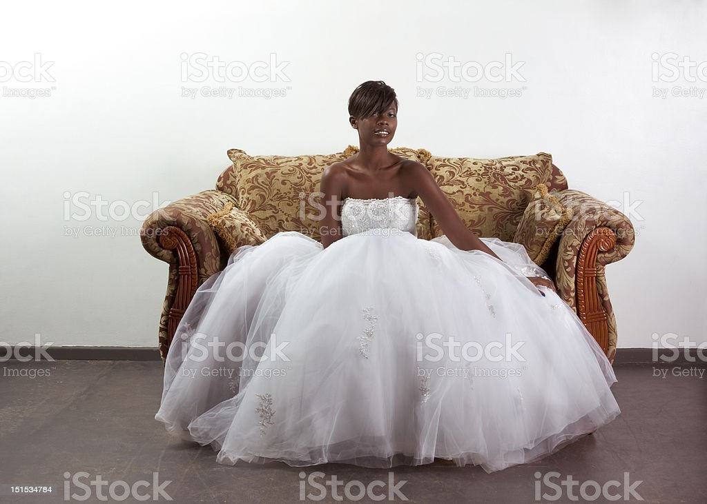 Young ethnic black woman bride in wedding dress stock photo
