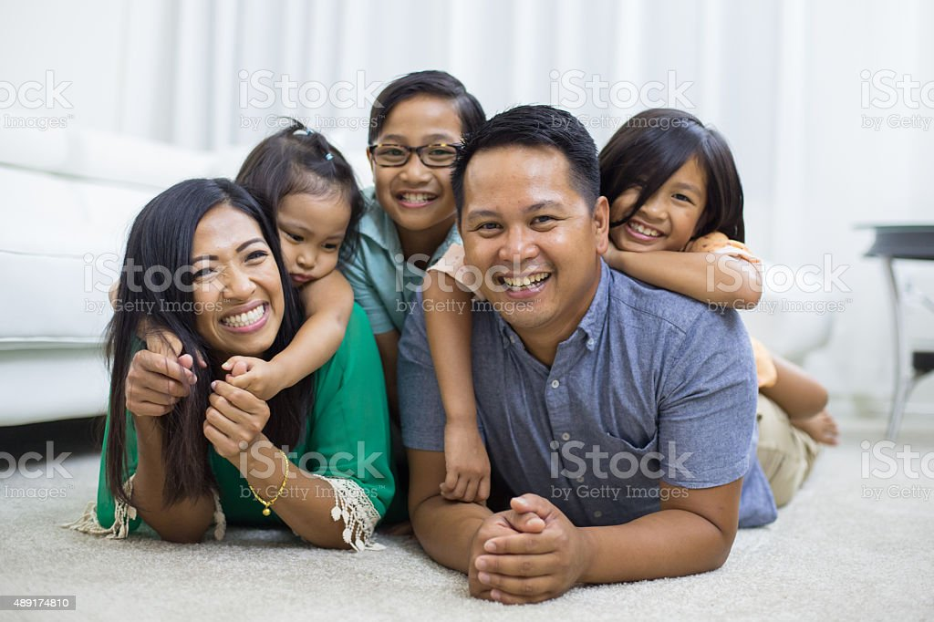 Young ethnic family stock photo
