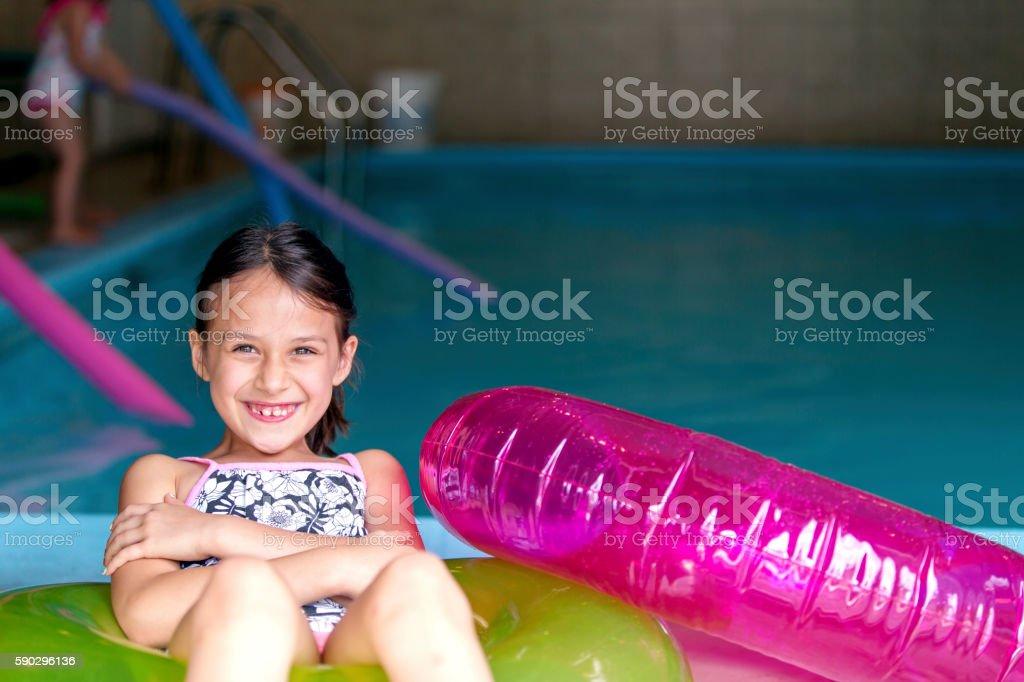 Young ethnic girl getting ready to swim in her pool royaltyfri bildbanksbilder