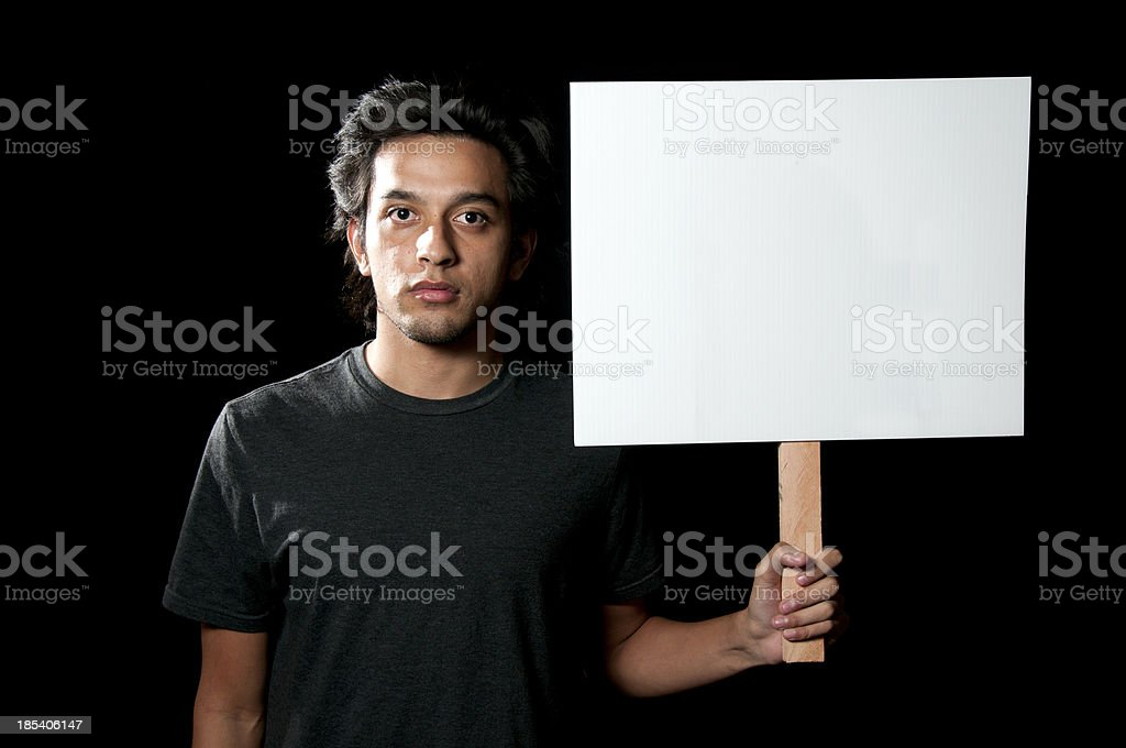 Young Ethnic Man Holding Blank Sign stock photo