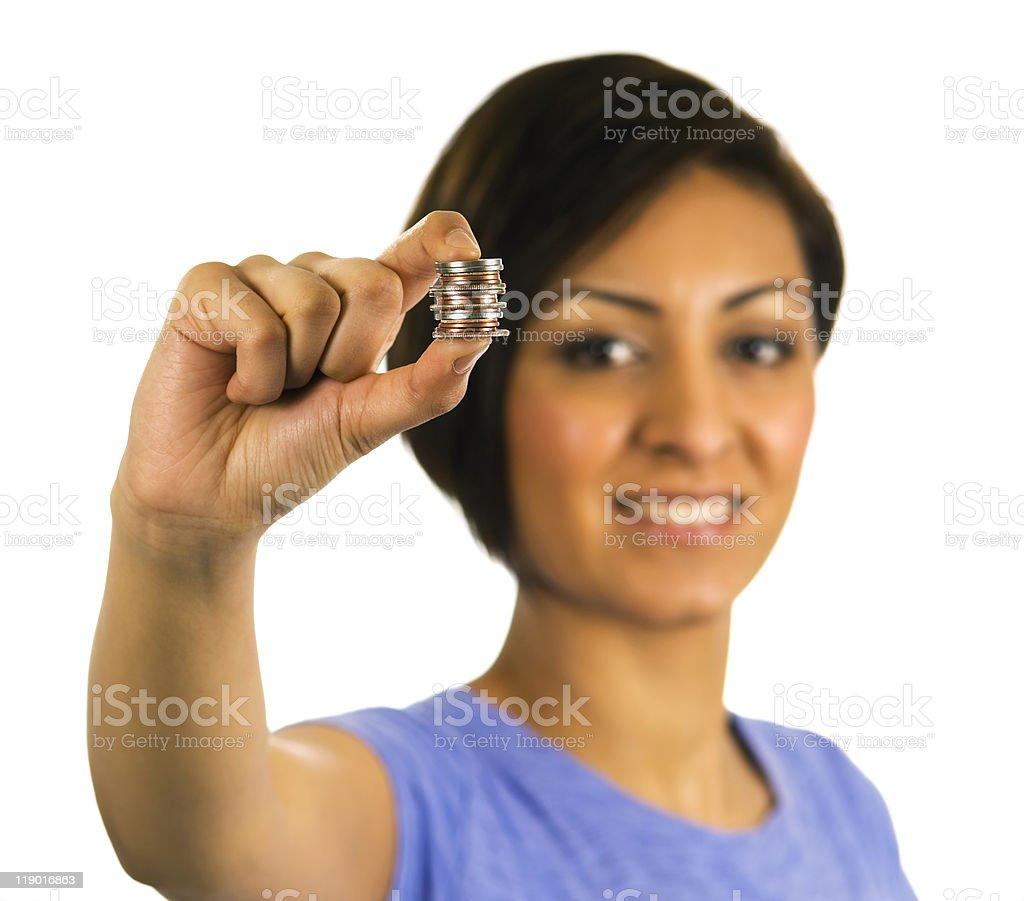 Young ethnic woman holds stack of coins. royalty-free stock photo