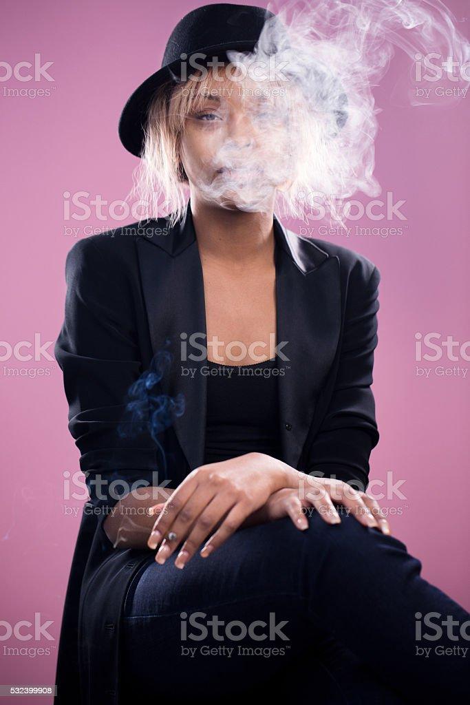 Young Ethnic Woman Smoking Marijuana stock photo