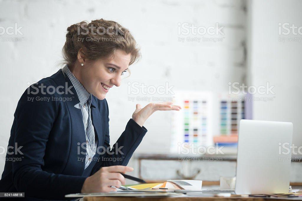 Young euphoric businesswoman stock photo
