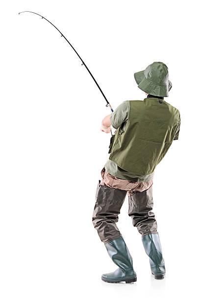 Young euphoric fisherman A young euphoric fisherman isolated on white background freshwater fishing stock pictures, royalty-free photos & images