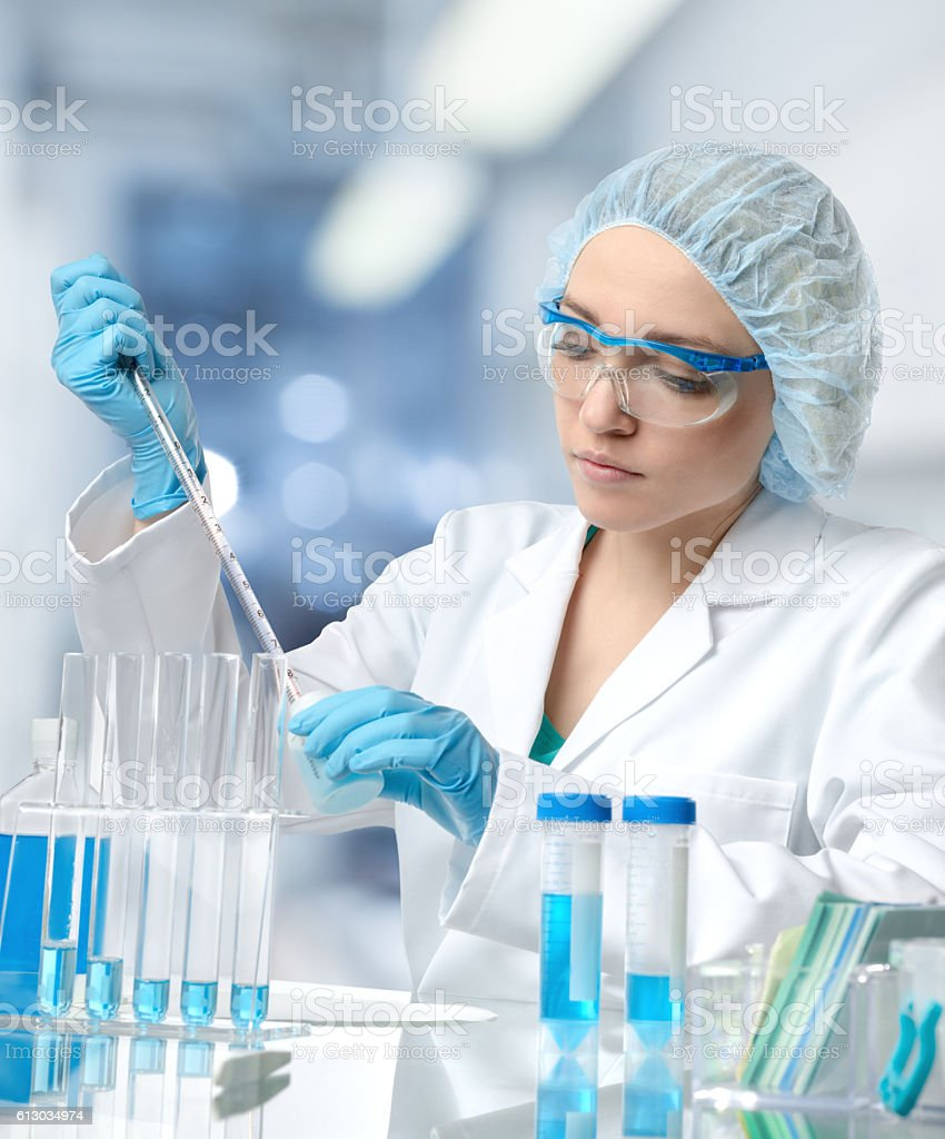 Young European female scientist or tech works in laboratory stock photo