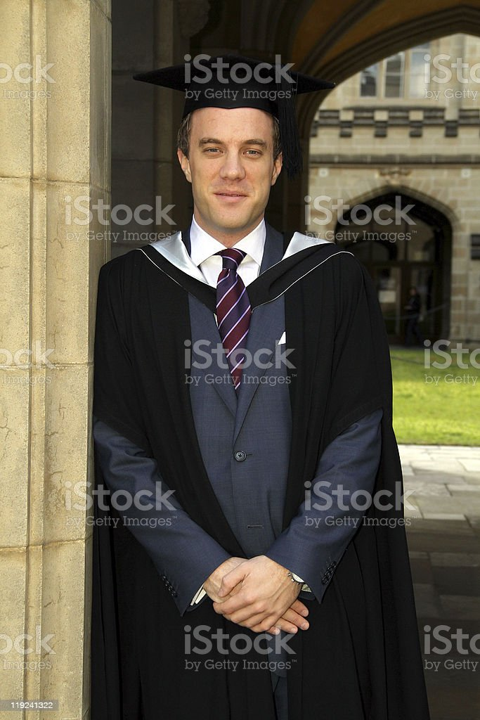 Young European Man In A Graduation Gown Stock Photo & More Pictures ...