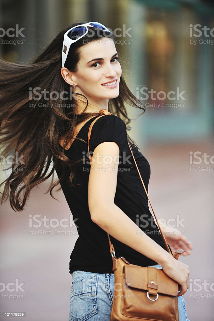 Young European woman at outdoor shopping mall royalty-free stock photo