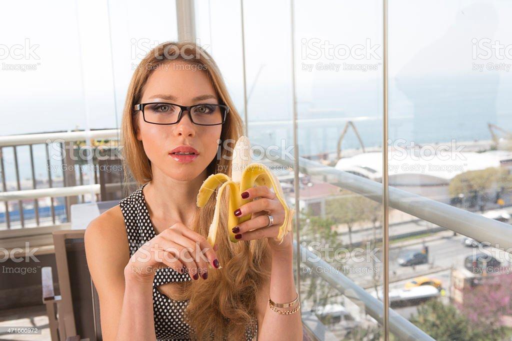 young european woman eating banana fruit in istanbul turkey stock photo