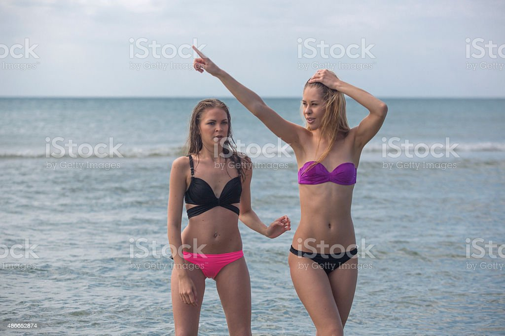 Young european women friends at marmara sea in istanbul turkey stock photo