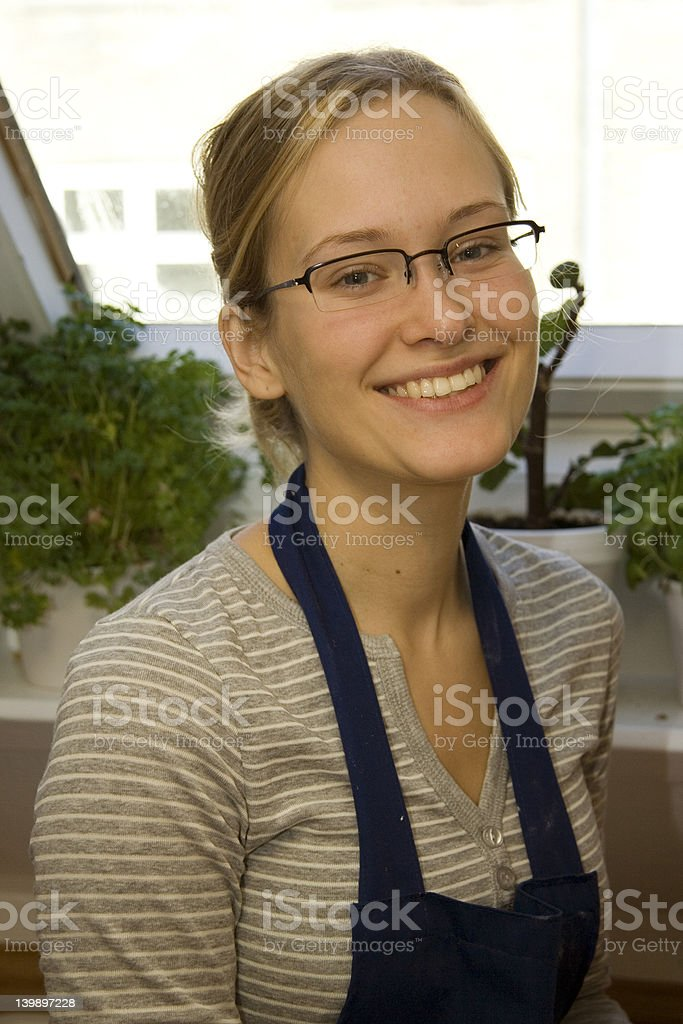 Young Eurpean Girl in the Kitchen royalty-free stock photo