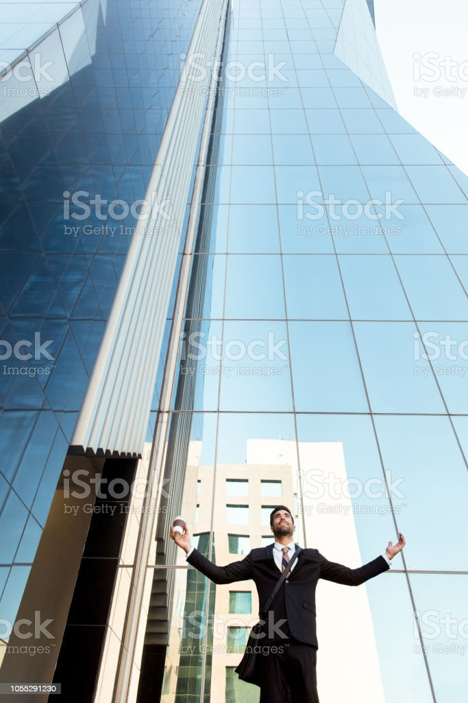 Young excited business man outside of large building stock photo