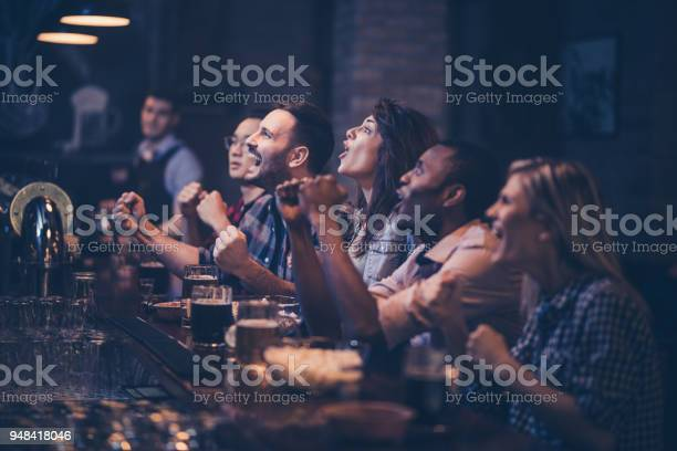 Young excited fans having fun in a bar while cheering for their team picture id948418046?b=1&k=6&m=948418046&s=612x612&h=sn483 xda6okilfmmbamzi5svf3hxvqxfuzkyegdyqc=